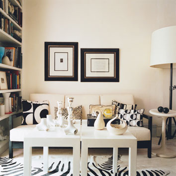 I love black and white rooms like the one shown here from a model home i decorated my family room and kitchen similarly to this which some people in my