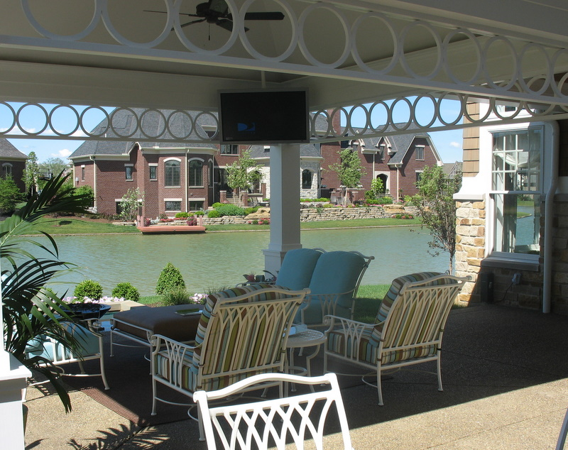 covered patio overlooking small pond