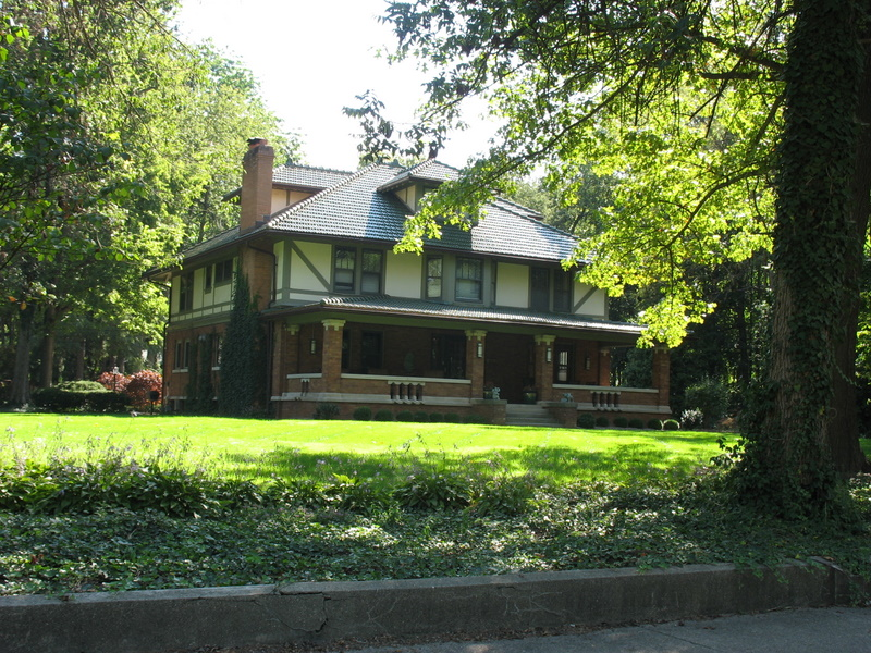 big old house with brick porch
