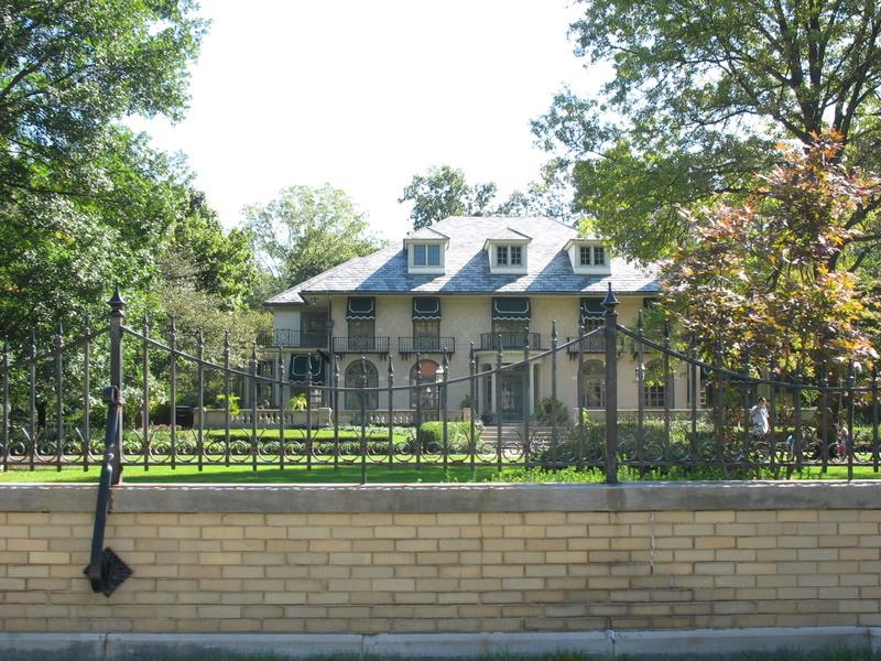 mansion behind iron gates